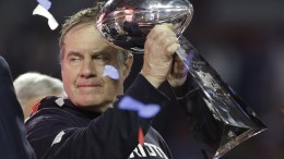 New England Patriots head coach Bill Belichick holds up the Vince Lombardi Trophy as he celebrates after the Patriots defeated the Seattle Seahawks 28-24 in NFL Super Bowl XLIX football game Sunday, Feb. 1, 2015, in Glendale, Ariz. (AP Photo/Patrick Semansky)
