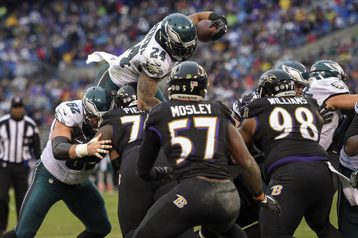 Philadelphia Eagles running back Ryan Mathews (24) dives over the Baltimore Ravens line for a two point conversion during the first half of an NFL football game in Baltimore, Sunday, Dec. 18, 2016. (AP Photo/Nick Wass)