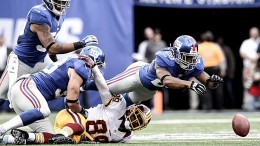 October 21, 2012; East Rutherford, NJ, USA; New York Giants cornerback Jayron Hosley jumps on a fumble after Washington Redskins wide receiver Santana Moss (89) is stripped of the ball by Giants linebacker Chase Blackburn (93) during the fourth quarter of an NFL game at MetLife Stadium. Mandatory Credit: Brad Penner-US PRESSWIRE