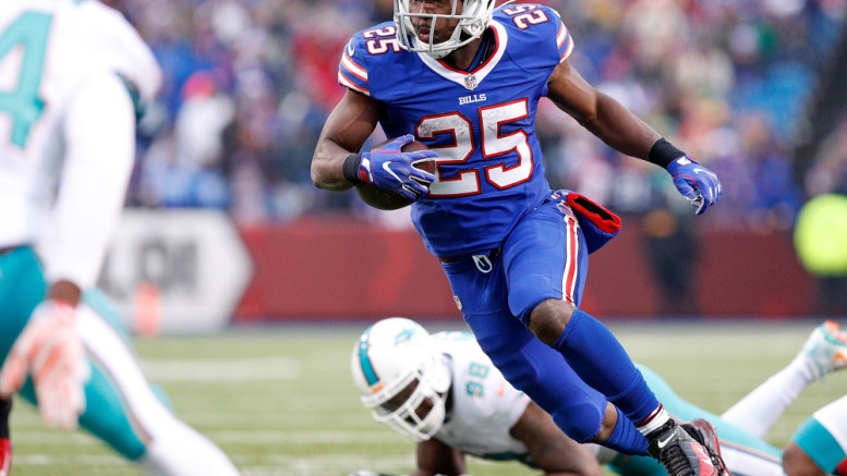 Dec 24, 2016; Orchard Park, NY, USA; Buffalo Bills running back LeSean McCoy (25) runs with the ball for a touchdown as Miami Dolphins defensive end Jason Jones (98) defends during the second half at New Era Field. The Dolphins beat the Bills 34-31 in overtime. Mandatory Credit: Kevin Hoffman-USA TODAY Sports